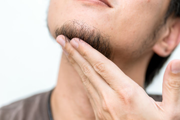 Closeup men beard with hand touching black hair at chin