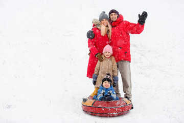 Picture of family walk with daughter and son on tubing in winter