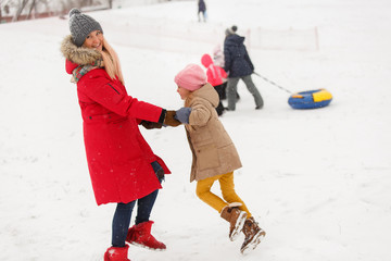 Image of mother and daughter on walk in winter park
