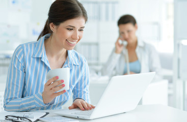 Young attractive woman working in office