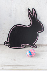 chalkboard bunny shape on white background with pink and purple pattered egg