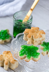 Saint Patrick's Day shamrock biscuits with green jelly and gold knife
