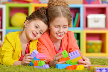 girls playing with colorful blocks