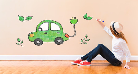 Electric Car with young woman holding a pen on floor