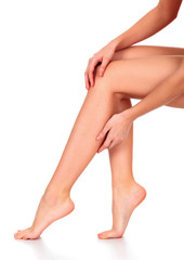 Beautiful long woman's legs and hands with smooth and soft skin isolated on white background