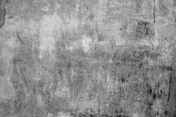 Wall fragment with scratches and cracks