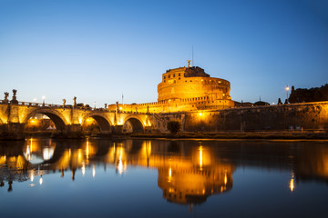 View of the Castle of St. Angelo or the Mausoleum of Hadrian and St. Angel's bridge at night, Italy
