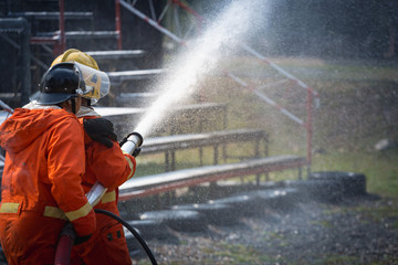 Firefighters training, Team practice to fighting with fire in emergency situation..Spray water to the flame