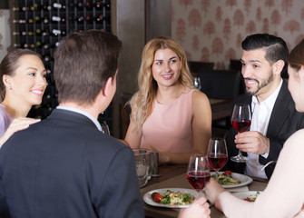 Friendly meeting over dinner with wine