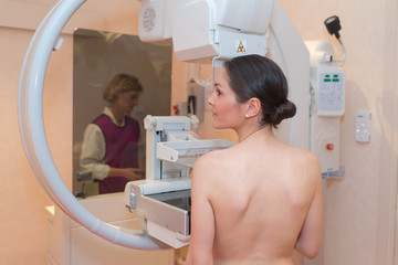 beautiful patient in the middle of a mammography