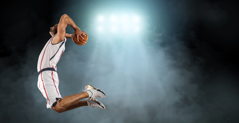 Caucassian Basketball Player in dynamic action with ball in a pr