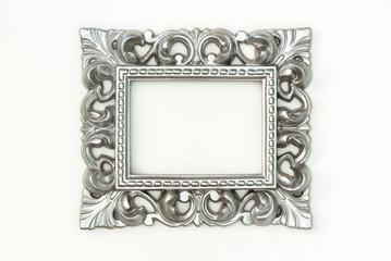 Ornate silver frame on white