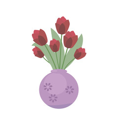 Fresh red festive tulips in a ceramic violet vase