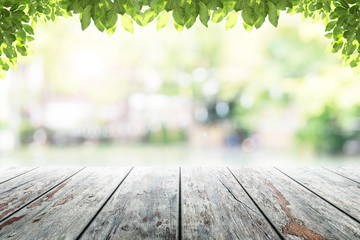 Empty wooden table with party in garden background blurred. Fototapete