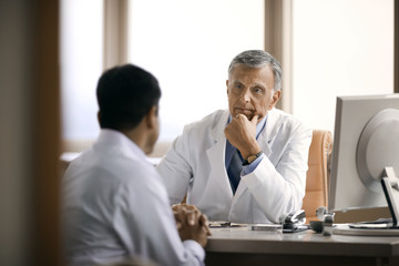 Doctor consulting with a patient in his office