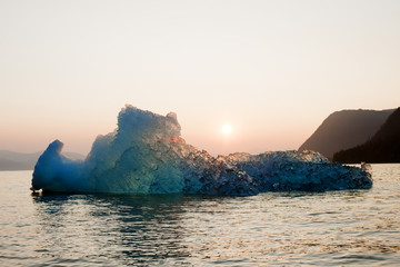 The setting sun illuminated a glacier on the ocean