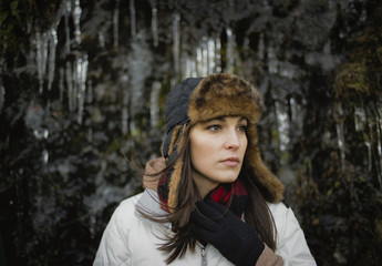 Portrait of brunette woman wearing a fur hat and scarf.