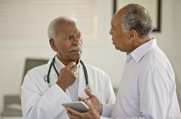 Two men talking in doctor's office
