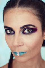 Portrait of the girl with creative art makeup with bright colors