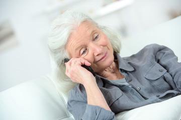 Elderly woman using telephone
