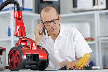 man with a robotic appliance