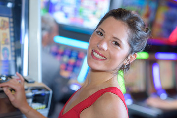 happy girl playing slot machines in las vegas