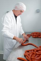 Butcher making sausages