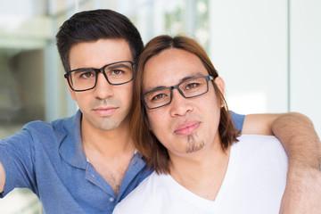 Two Serious Men Taking Selfie Photograph