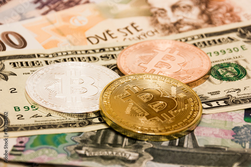 Symbolic Coins Of Bitcoin On Banknotes Us Dollars Czech Crowns And Russian Rubles