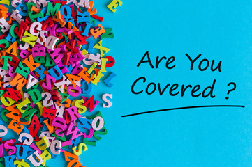 Many little alphabets letters and inscription - Are you covered. Insurance concept