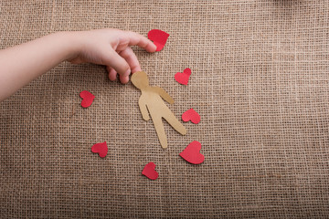 Hand and paper hearts and man for  Love concept