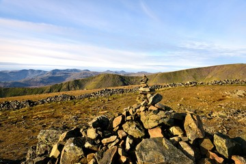 Sunlight on the marker cairn of Dove Crag