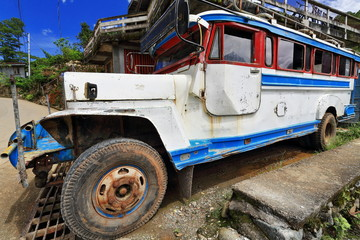 Filipino white-blue dyipni-jeepney stationed beside south road. Sagada town-Mountain province-Philippines. 0224