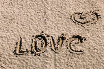 "Word ""love"" on the sand"