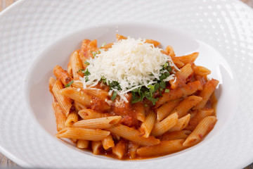 pasta penne with parmesan cheese tomato sauce greens