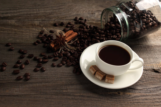 Cup of cofee with sugar and cofee beans
