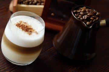 Delicious coffee latte with cinnamon in a glass