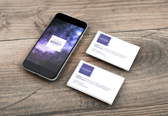 Smartphone and Business Cards on Wooden Background Mockup 1