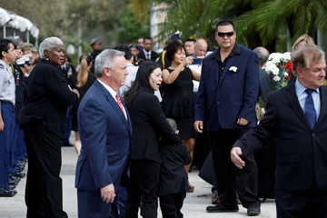 Mourners attend the funeral service for Marjory Stoneman Douglas High School student Peter Wang in Coral Springs
