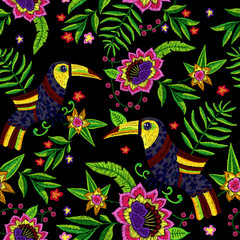 Embroidery tropical seamless pattern with exotic flowers and toucans. Vector embroidered floral illustration with bird for clothing design.