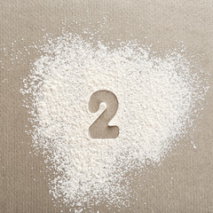Silhouette of figure 2 on scattered flour