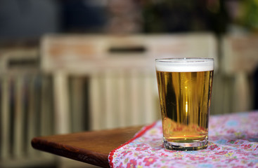 Casual photo: glass of beer on bar