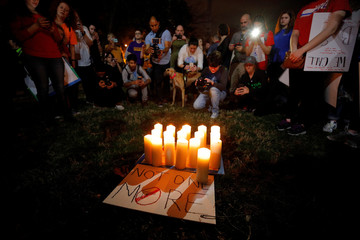 People take pictures of seventeen candles placed in memory of the victims of the shooting at Marjory Stoneman Douglas High School, outside the North Carolina State Capitol building after a demonstration calling for safer gun laws, in Raleigh