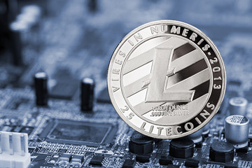 litecoin crypto currency mining financial concept silver coin on hardware computer chip motherboard