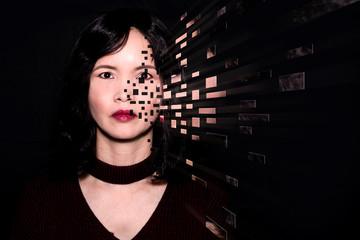 A close up portrait of an oriental woman with pixelated dispersion
