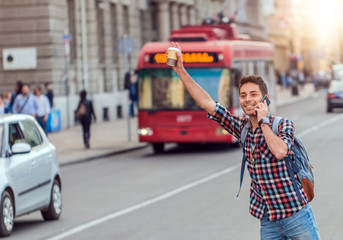 Man hailing taxi on city street