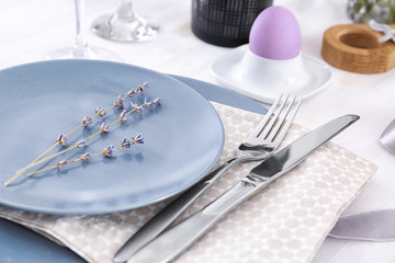 Beautiful festive Easter table setting with lavender, closeup