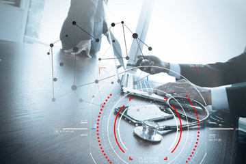 Concept of target focus digital diagram and Graph interfaces with connections netwoork.Medical doctor working at modern hospital