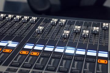 hand push volume up. ,mixer music in studio., professional sound engineer.