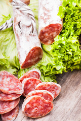 Sausage salami with noble mold and lettuce